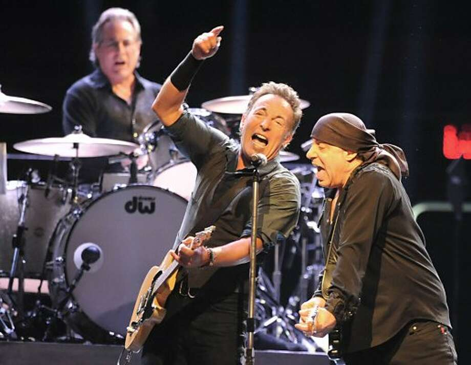 Bruce Springsteen sings with Steve Van Zandt while Max Weinberg plays drums at a sold out performance at the Times Union Center on April 16, 2012 in Albany, N.Y. (Lori Van Buren / Times Union) (Albany Times Union)