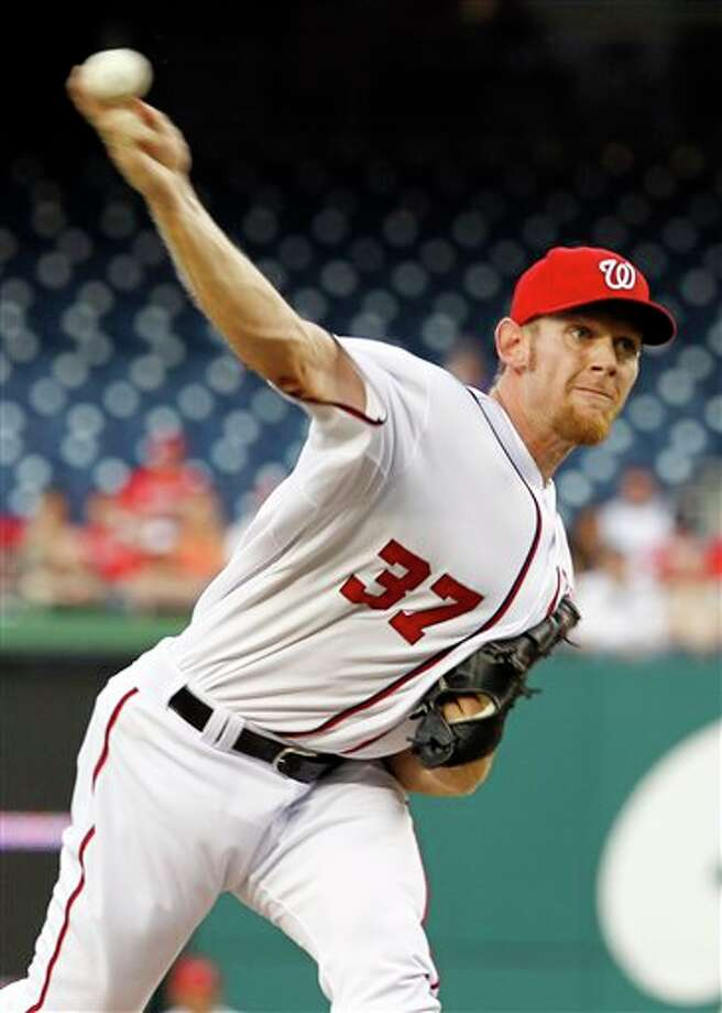 Washington Nationals starting pitcher Stephen Strasburg throws to the Houston Astros during the first inning of a baseball game in Washington, Monday, April 16, 2012. (AP Photo/Ann Heisenfelt) Photo: Associated Press