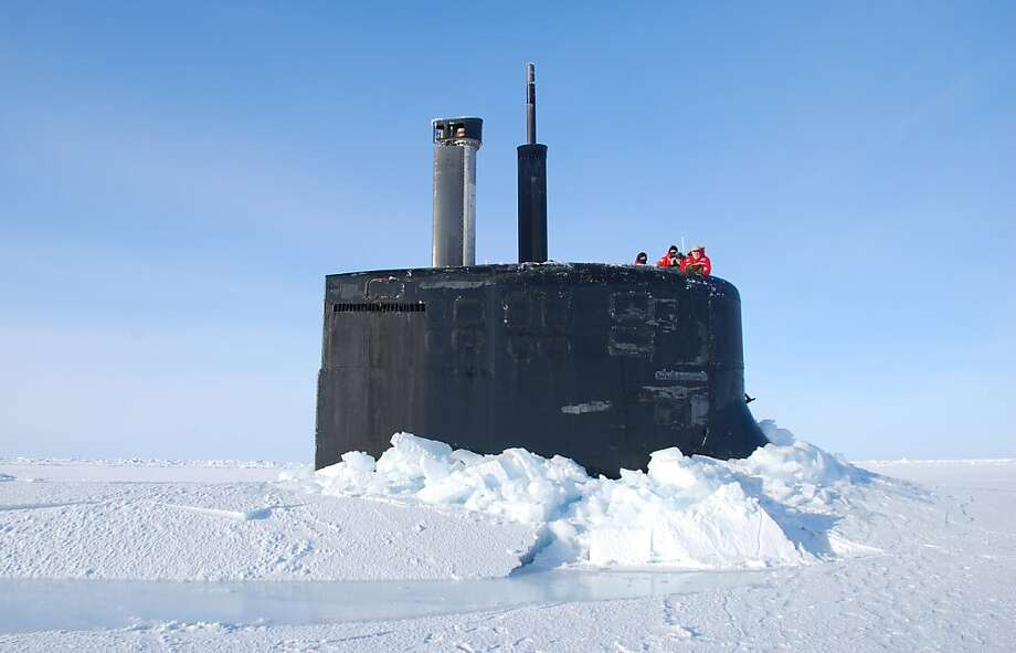 In this March 19, 2011 photo released by the U.S. Navy, crew members look out from the USS Connecticut, a Sea Wolf-class nuclear submarine, after it surfaced through ice in the Arctic Ocean. The U.S. and other countries are building up their military presence in the Arctic to help exploit its riches - and protect shifting borders.  (AP Photo/U.S. Navy, Cmdr. Christy Hagen) Photo: Cmdr Christy Hagen, Associated Press