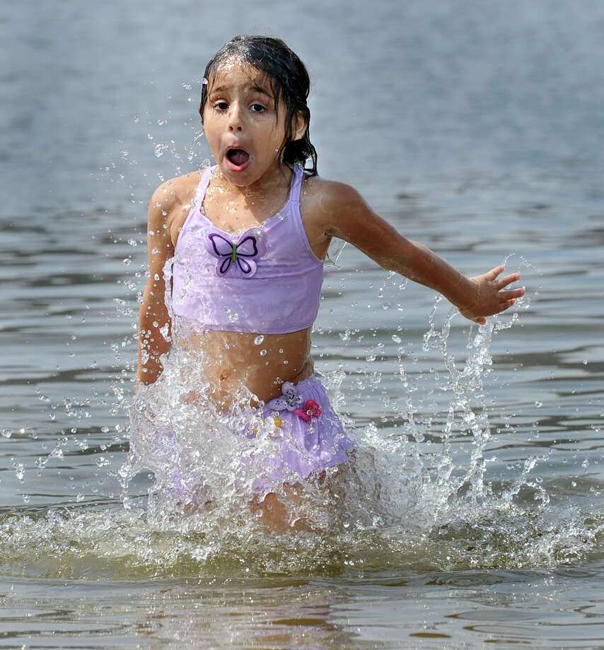 Emilee Jeminez, 5, of Bethel, takes her first dip of the season into the water at Danbury Candlewood Park, and pronounces it very cold, Monday, April 16, 2012. Photo: Carol Kaliff