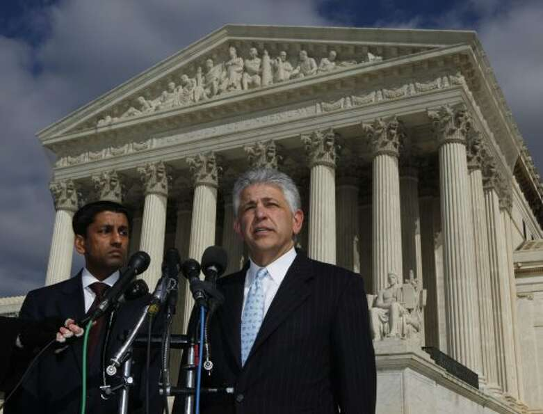 Daniel Petrocelli, right, lead lawyer for former Enron CEO Jeffrey Skilling, speaks to reporters out