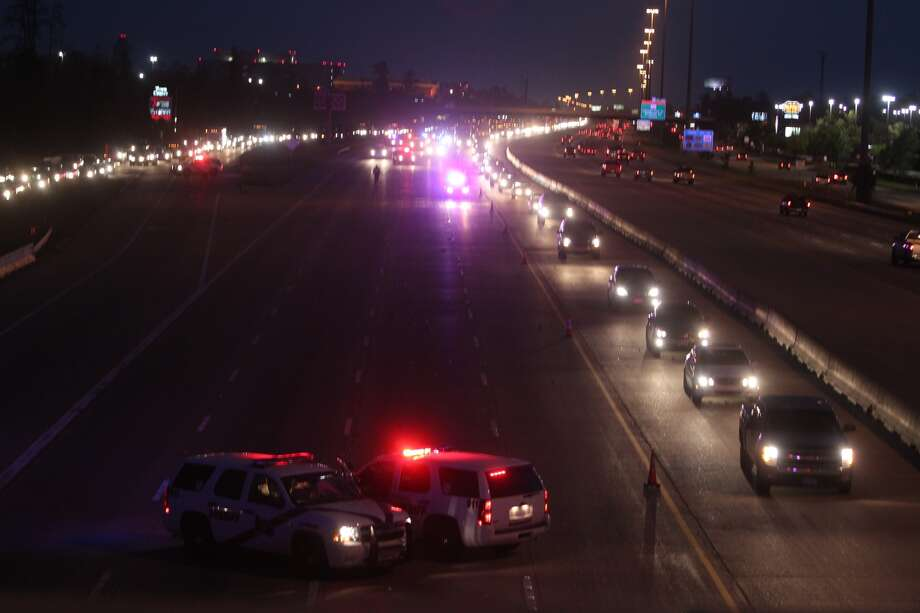 Police investigate a fatal shooting on Interstate 45 north of Houston on Tuesday. (Johnny Hanson/Chronicle)