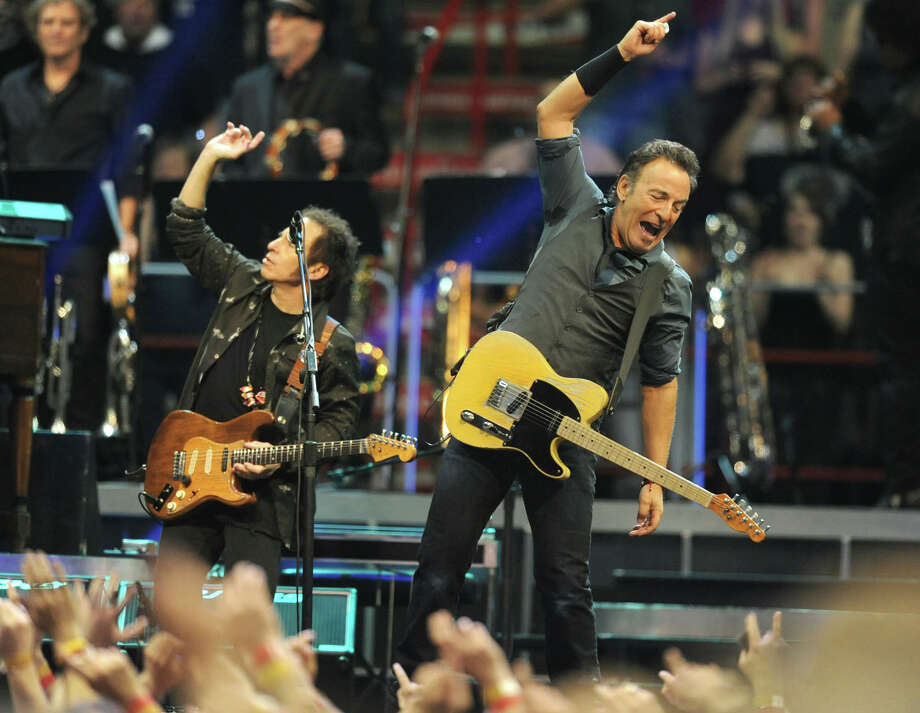 Bruce Springsteen and Nils Lofgren get the crowd going during a sold out concert at the Times Union Center on April 16, 2012 in Albany, N.Y. (Lori Van Buren / Times Union) Photo: Lori Van Buren, Albany Times Union / 00017239A