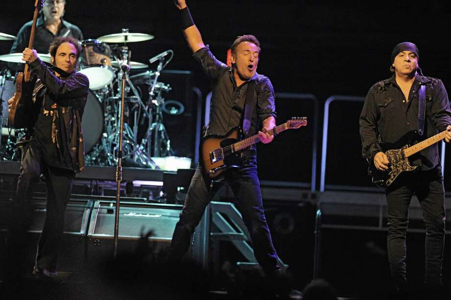 Bruce Springsteen performs to a sold out crowd at the Times Union Center on April 16, 2012 in Albany, N.Y. His original E-Street Band members Nils Lofgren, left, Steve Van Zandt, right, and Max Weinberg on drums back him up well. (Lori Van Buren / Times Union) Photo: Lori Van Buren, Albany Times Union / 00017239A