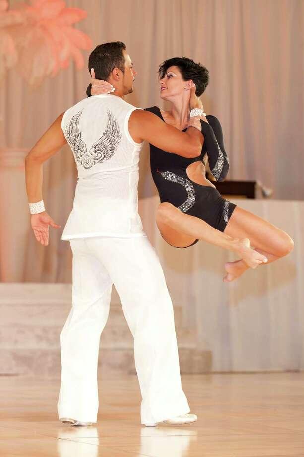 Ballroom dance champsions Eric Luna and Georgia Ambarian defied gravity during Dance Kaleidoscope. Photo: Courtesy San Antonio Metropolitan Ballet / c2009             c2009