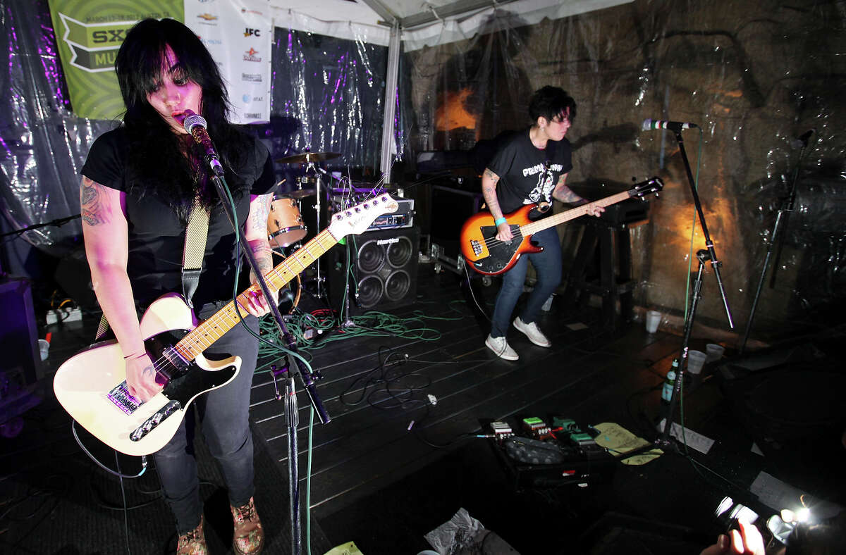 FOR METRO - Girls in a Coma's Nina Diaz (from left) Phanie Diaz (not pictured) and Jenn Alva, from San Antonio, perform at the Easy Tiger during South by Southwest Saturday March 17, 2012 in Austin, TX.