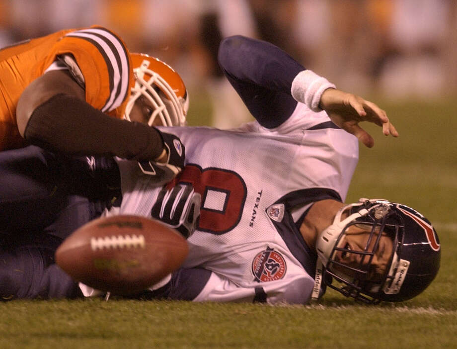 Quarterback David Carr often found himself lying on the turf during the Texans' first season in 2002. Photo: Smiley N. Pool, Houston Chronicle / HOUSTON CHRONICLE