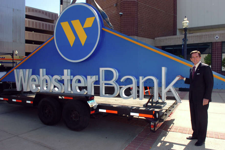 James C. Smith, Chairman, President and Chief Executive Officer Webster Bank and Webster Financial Corporation poses next to part of the Webster Bank sign before it is lifted into place on the Webster Bank Arena at Harbor Yard in Bridgeport, Conn. May 12th, 2011. Photo: Ned Gerard, ST / Connecticut Post