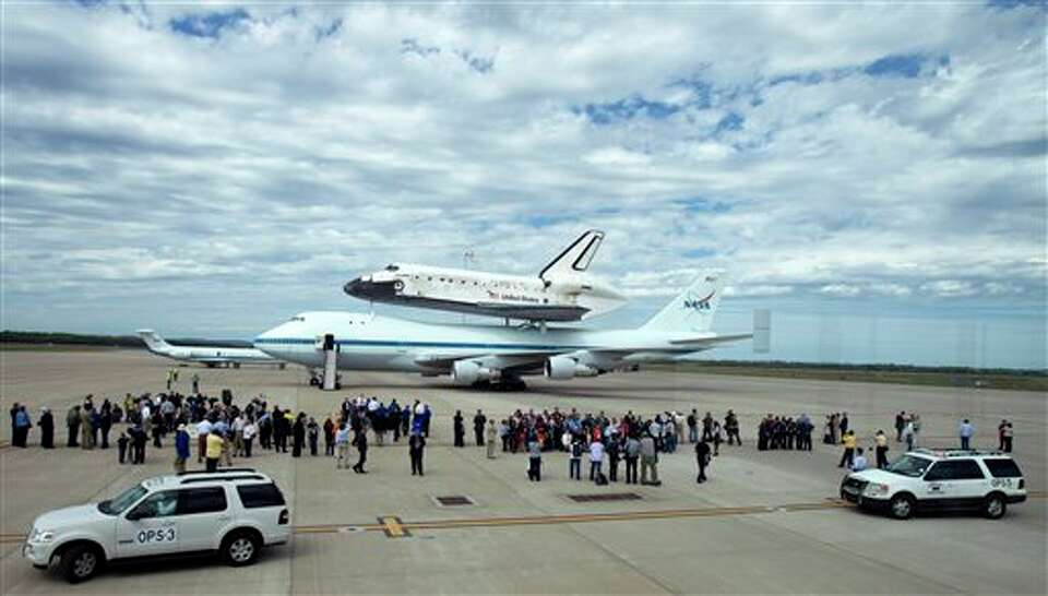 The space shuttle Discovery mated atop a 747 carrier aircraft sits on the tarmac at Dulles Internati