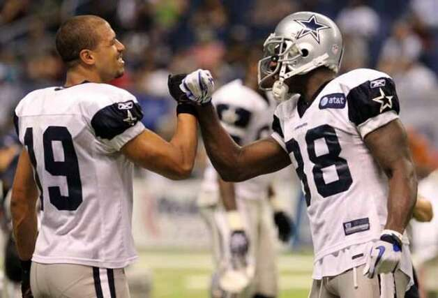 Receivers Miles Austin (left) and Dez Bryant interact during the evening session of the Dallas Cowboys training camp at the Alamodome on Thursday, Aug. 4, 2011. Kin Man Hui/kmhui@express-news.net (SAN ANTONIO EXPRESS-NEWS)