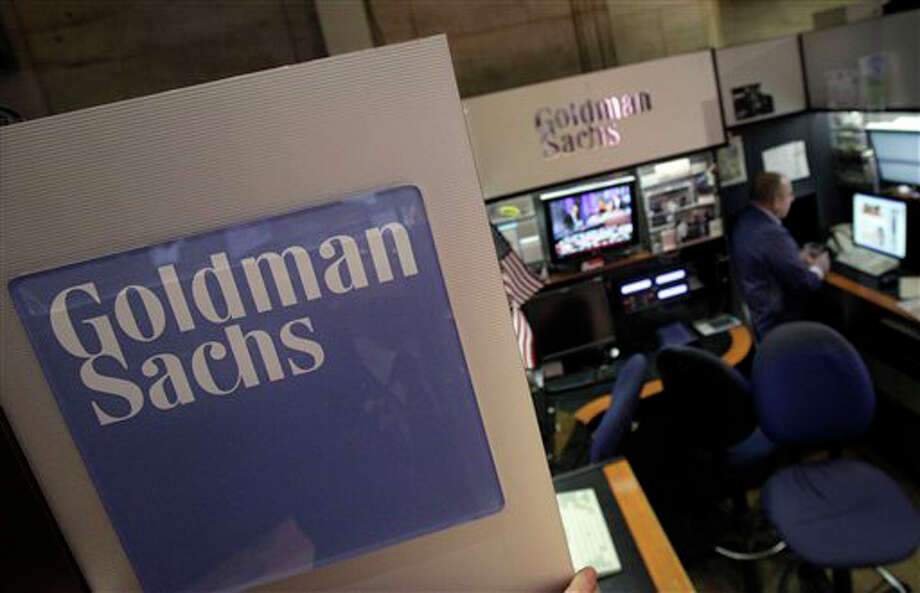 A trader works in the Goldman Sachs booth on the floor of the New York Stock Exchange. Goldman Sachs more than doubled its first-quarter profits and announced plans to raise its dividend Tuesday, April 17.  The strong results masked other problems, including a 16 percent decline in revenue. To make up for that, and to propel earnings higher, Goldman turned to cost-cutting. (AP Photo/Richard Drew) Photo: Contributed Photo / Stamford Advocate Contributed