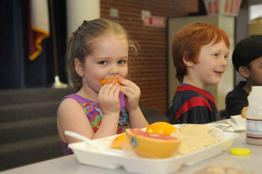 Audrey Simms eats her orange during lunch at Smith Elementary in Spring. Photo: Jerry Baker