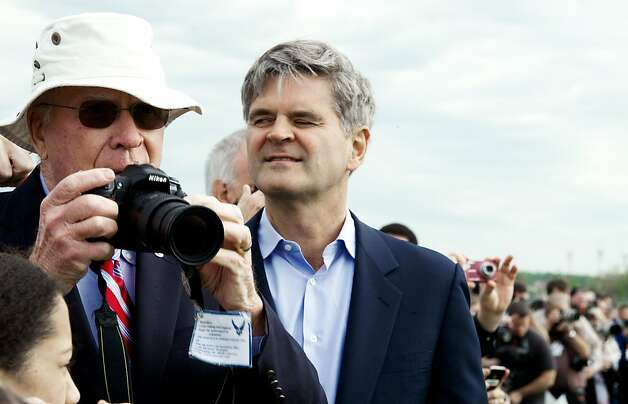 US Senator Patrick LeahyD-VA snaps photos as former AOL Chairman & CEO Steve Case(R) watch the Space Shuttle Discovery and NASA's Boeing 747  Shuttle Carrier Aircraft(SCA) land at Washington, Dulles International Airport  April 17, 2012. The shuttle is on it's way to it's new permanent display at the Smithsonian National Air and Space Museum's Steven F. Udvar-Hazy Center in Chantilly, Virginia.        AFP Photo/Paul J. Richards (Photo credit should read PAUL J. RICHARDS/AFP/Getty Images) Photo: Paul J. Richards, AFP/Getty Images