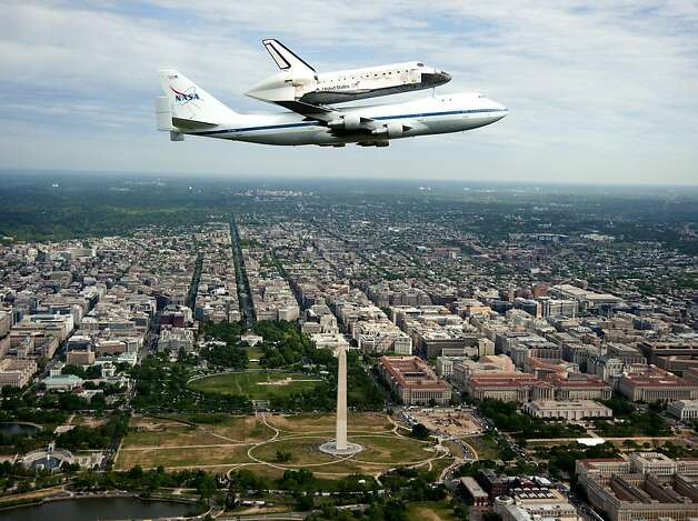 WASHINGTON, DC - APRIL 17:  In this handout provided by NASA, space shuttle Discovery is tethered to the back of NASA 905 Shuttle Carrier Aircraft (SCA), a modified Boeing 747 jumbo jet, as it as it does a fly over of the U.S. Capitol April 17, 2012 in Washington, DC. The oldest and most traveled vehicle in NASA's space shuttle program, Discovery will be placed on permanent display at the Smithsonian National Air and Space Museum Steven F. Udvar-Hazy Center.  (Photo by Robert Markowitz/NASA via Getty Images) Photo: Nasa, Getty Images
