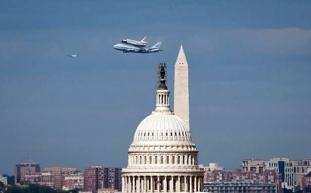 Space shuttle Discovery, mounted atop a NASA 747 Shuttle Carrier Aircraft (SCA) flies near the U.S. Capitol, Tuesday, April 17, 2012, in Washington, D.C. (Rebecca Roth/NASA/MCT) Photo: Rebecca Roth, McClatchy-Tribune News Service