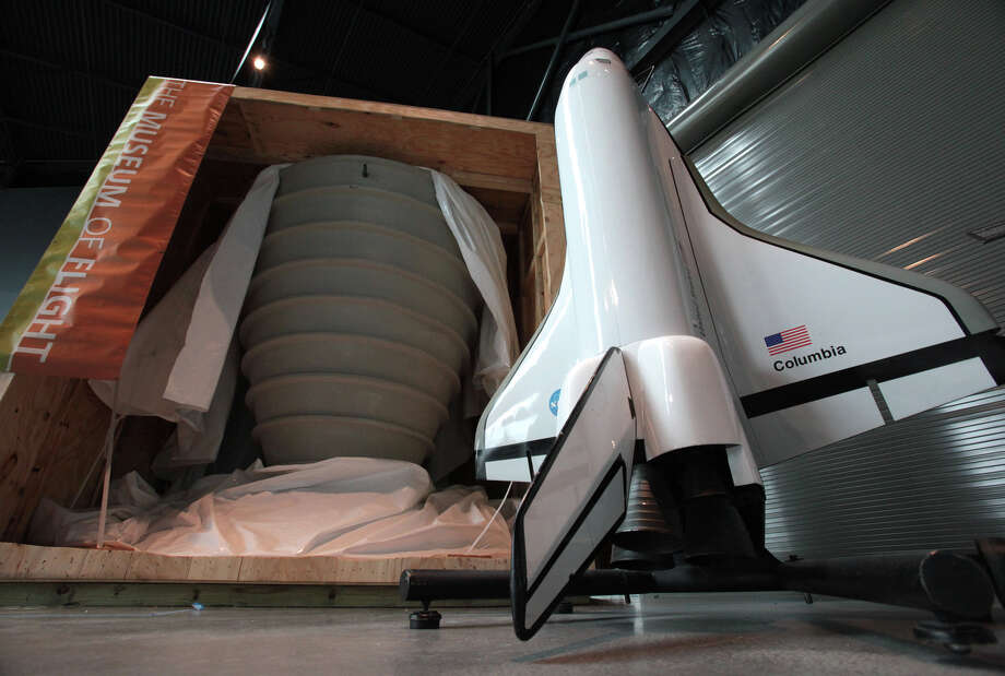 A Full Fuselage Space Shuttle Trainer engine bell is shown next to a model of the Space Shuttle in the Charles Simonyi Space Gallery after being unveiled on Tuesday, April 17, 2012 at Seattle's Museum of Flight. The shipment was the first portion of NASA's Full Fuselage Space Shuttle Trainer to arrive at The Museum of Flight. The trainer will be permanently housed in the Space Gallery at the museum. Photo: JOSHUA TRUJILLO / SEATTLEPI.COM