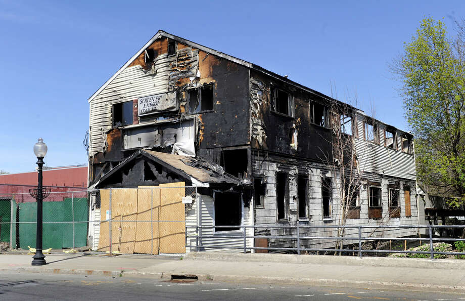 This building on Crosby Street that was destroyed by a fire more than three months ago is set to be torn down next week, the property owner said Monday, April 16, 2012. Mark Nolan, the owner of the Crosby Street building that once housed a screen printing shop, said all the necessary environmental testing has been completed and demolish should start next week. Photo: Carol Kaliff / The News-Times