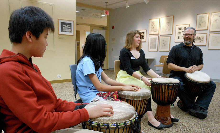 Drummer Mark Zarrillo, far right, leads a drum circle exercise Saturday at Westport Public Library. Photo: Mike Lauterborn / Westport News contributed