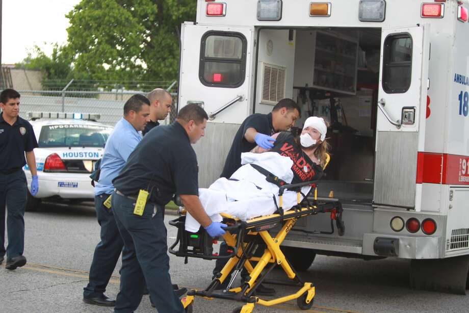 The driver of a police chase that ended Tuesday afternoon in the 2000 block of South Wayside is placed into an ambulance. Photo: Nick De La Torre, Houston Chronicle