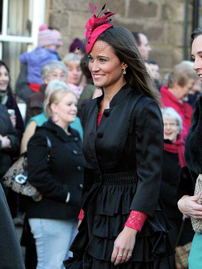 FILE - In this file photo dated Saturday, Feb. 26, 2011 Britain's Pippa Middleton, arrives at the wedding of the Duke and Duchess of Northumberland's eldest daughter Lady Katie Percy to city financier Patrick Valentine at St Michael's Church in Alnwick, England. Pippa Middleton went to Paris for a friend's birthday party and the British media are agog over an alleged gun flashed at paparazzi by one of her companions. Paris police say they've received no complaint and are not investigating, Tuesday, 17 April, 2012. (AP Photo/Scott Heppell, File) Photo: SCOTT HEPPELL / AP