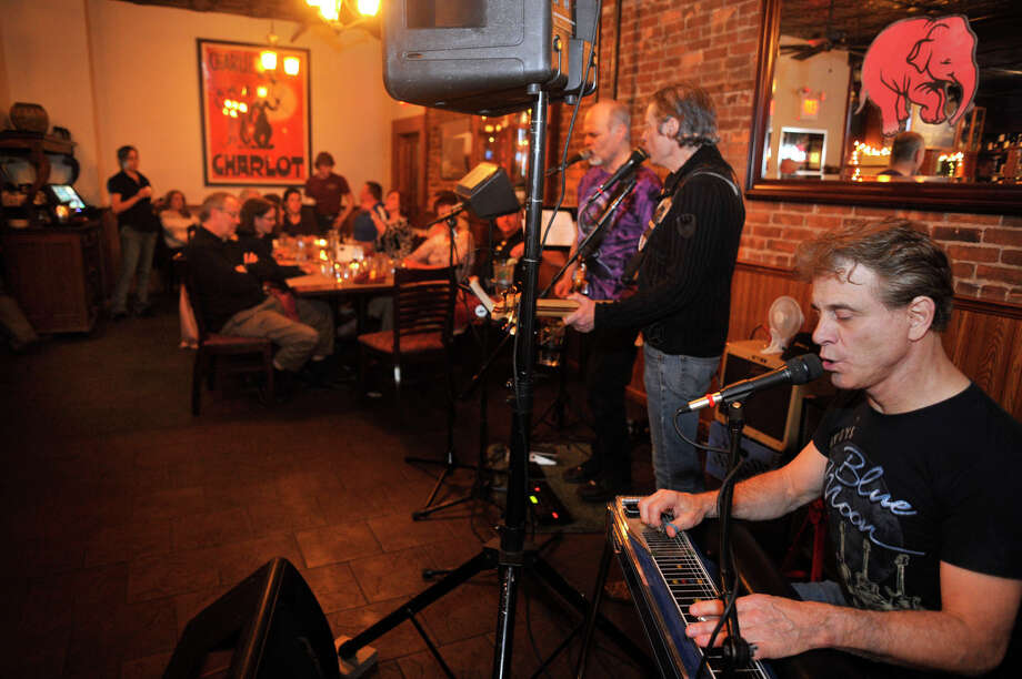 The band 3 of a Kind plays at Greenwood's Grille & Ale House in Bethel on Saturday, April 14, 2012. Members of the band, from right, are John Veglia, Richard Egnor and Russ Brode. Photo: Jason Rearick / The News-Times