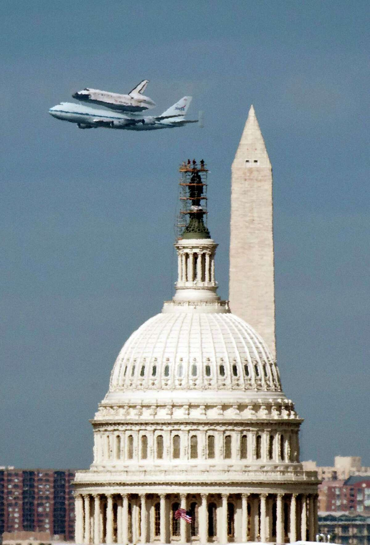 Space Shuttle Discovery, mounted on the Shuttle Carrier Aircraft, flies over the U.S. Capitol on Tuesday..
