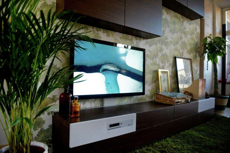 An LED television and sound system integrated in the furniture are part of a mock-up for Swedish home furniture company Ikea's venture into home electronics, shown to the press in Stockholm. Photo: JESSICA GOW / SCANPIX SWEDEN