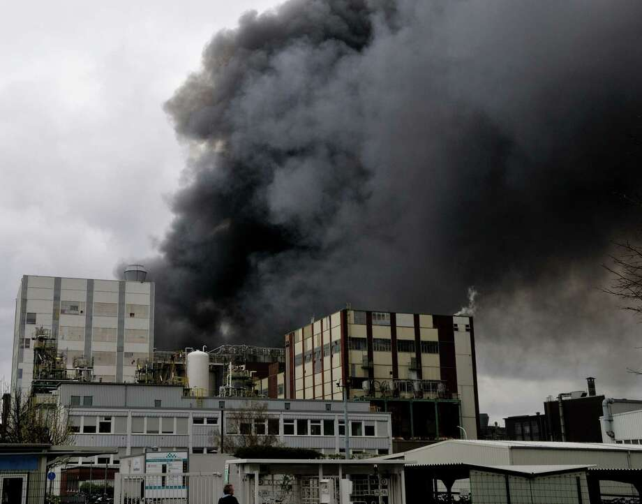 Smoke billows from a chemical industry facility in Marl, western Germany, Saturday, March 31, 2012, after an explosion occurred. German news agency dapd reported that one employee suffered severe burns and was taken to a hospital by helicopter after the early-afternoon incident in the Ruhr industrial region. Another three people were missing. Photo: Ralf Deinl, AP / dapd