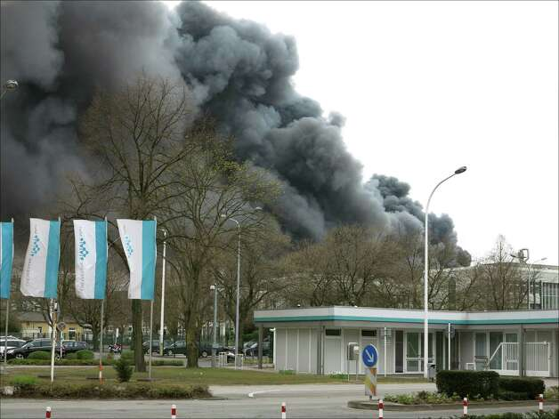 A black cloud can be seen at a chemical industrial park in Marl, western Germany, after an explosion happened on March 31, 2012. According to the police in Recklinghausen, at least two persons were injured when a boiler plant of the company Degussa exploded.      AFP PHOTO / Phil Griffin    GERMANY OUT Photo: PHIL GRIFFIN, AFP/Getty Images / 2012 AFP