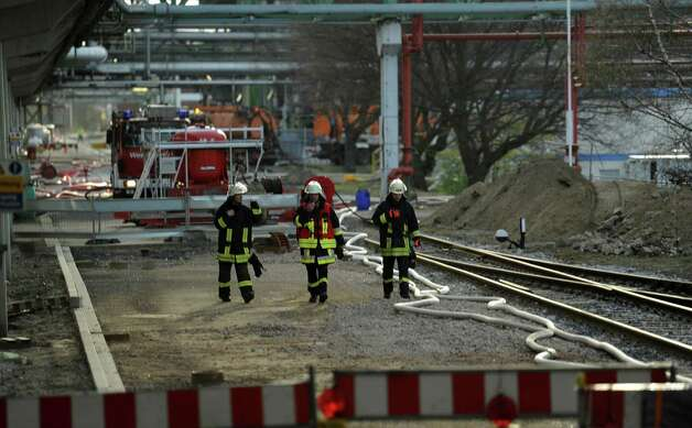 Fire brigades work at the chemical industrial park in Marl, western Germany, on March 31, 2012. One person was seriously injured and three were missing after an explosion at the chemical plant, rescuers said. The explosion of a tank at the Evonik Degussa plant sent gas clouds billowing over the town, and residents were warned to stay indoors, with their windows and doors closed.     AFP PHOTO / PATRIK STOLLARZ Photo: PATRIK STOLLARZ, AFP/Getty Images / 2012 AFP