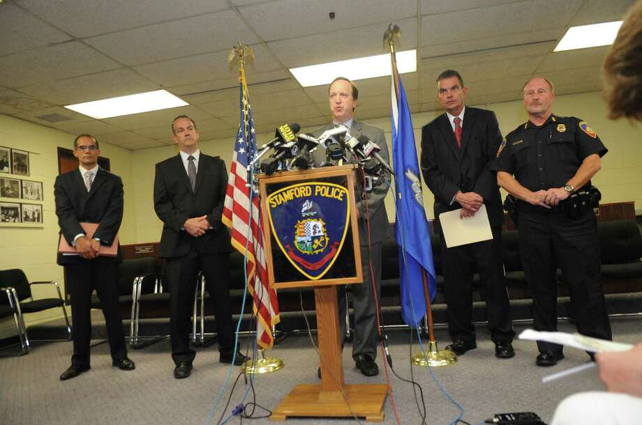 From left, Assistant U.S. attorney Rahul Kale, DEA Special Agent Brian Boyle, U.S. Attorney David B. Fein, Westchester County Commissioner of Public Safety George Longworth and Stamford Police Chief Robert Nivakoff, hold a news conference Tuesday at the Stamford Police Department on Bedford Street to announce the arrests of 20 people in a drug trafficking ring that smuggled tens of thousands of prescription painkillers through Florida and Westchester County airports. Photo: Helen Neafsey / Greenwich Time