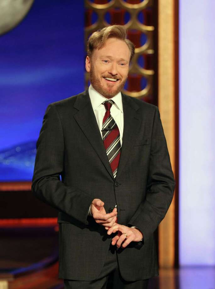 "In this publicity image released by Team Coco, Conan O'Brien, host of the new ""Conan"" show on TBS speaks during his monologue, Tuesday, Nov. 9, 2010.  With Election Day 2012 looming a year away, Republicans trying to unseat President Obama are getting lampooned by late-night TV comics. (AP Photo/Team Coco, Meghan Sinclair) Photo: Meghan Sinclair / AP2010"