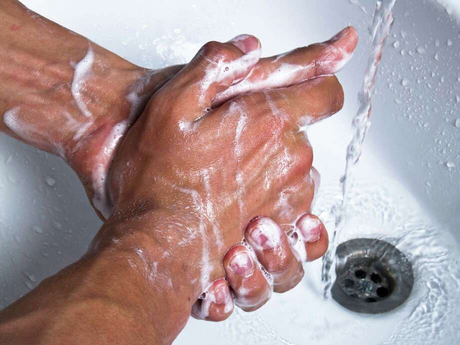Man washing hands with soap at sink. Photo: Fotolia