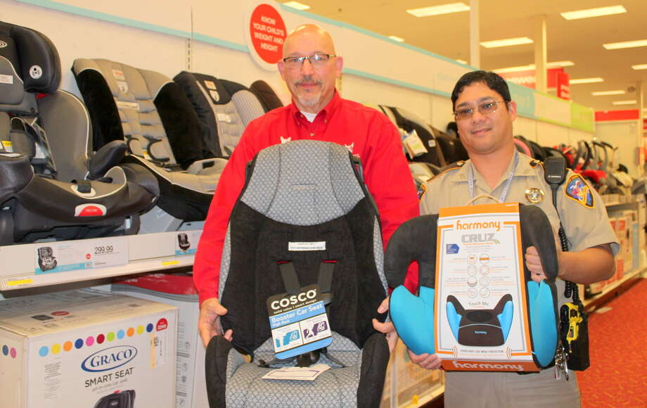 Steve Francis, left, executive team leader for the Target Store, 23710 Westheimer Parkway in Cinco Ranch, and Gerard Argao, safety deputy for the Fort Bend County Sheriff's Office, are preparing for the free car seat checkup on April 26.