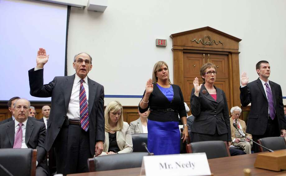 Witnesses of sworn in on Capitol Hill in Washington, Tuesday, April 17, 2012, prior to testifying before a House Transportation subcommittee hearing to investigate an excessive conference at a Las Vegas resort by General Services Administration officials in 2010. From left are, former GSA Public Buildings Service Commissioner Robert Peck, suspended GSA Public Buildings Service event planner Lisa Daniels, Martha Johnson, who stepped down as GSA administrator because of the scandal, and David Foley, deputy commissioner of the GSA Public Buildings Service. (AP Photo/J. Scott Applewhite) Photo: J. Scott Applewhite / AP