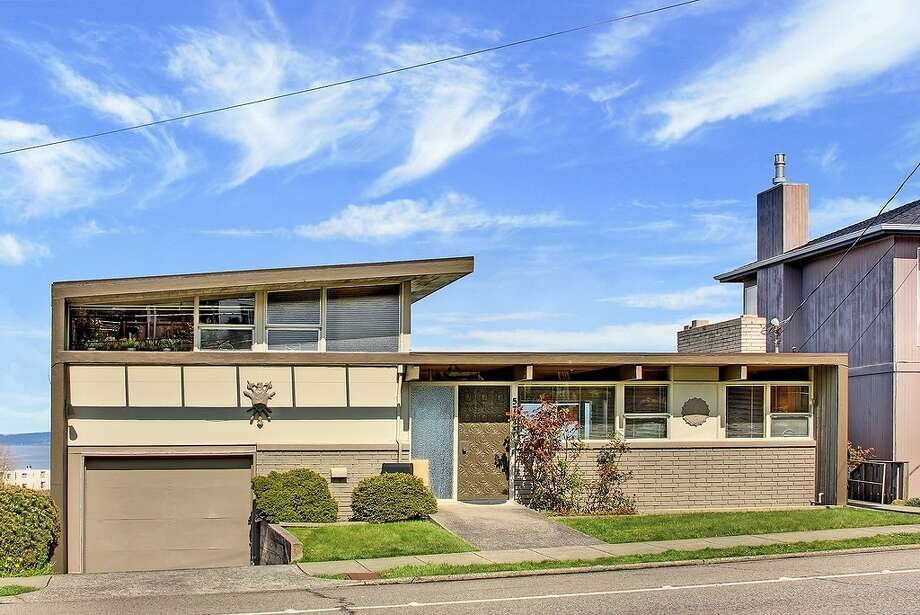 West Seattle's Alki neighborhood features a beautiful beach, views of Elliott Bay and Puget Sound and some nifty mid-century modern homes. Here are a few, plus a one from a slightly earlier era, all for between $550,000 and $650,000. First comes 5730 S.W. Admiral Way. The 2,100-square-foot home, built in 1956, has three bedrooms, two bathrooms, two fireplaces, dark-stained beams, a wood ceiling, bamboo trim and floor-to-ceiling windows on a 4,483-square-foot lot. It's listed for $575,000, although a sale is pending. Photo: Courtesy Heidi Ward/Coldwell Banker Bain