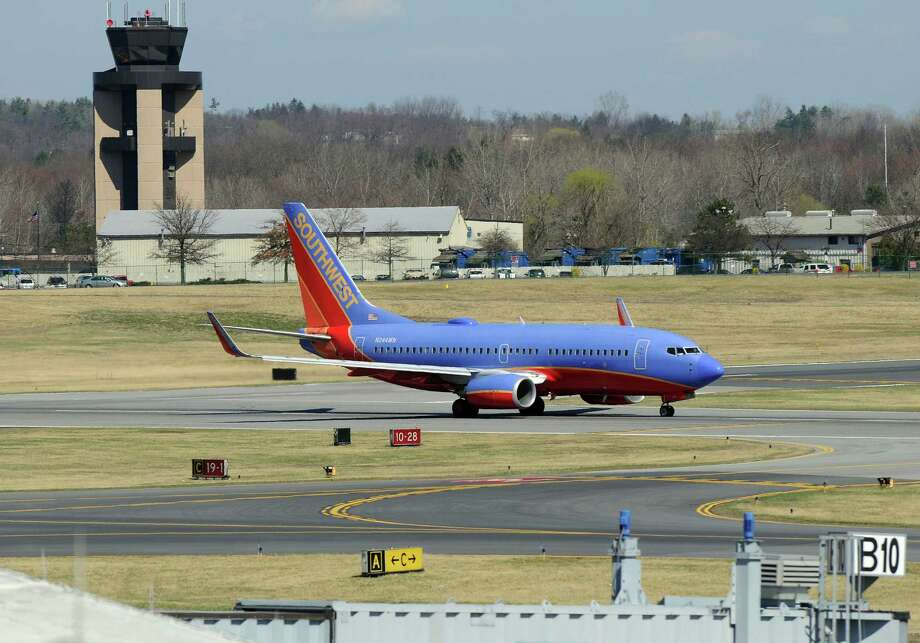 A Southwest Airlines takes off from the Albany International Airport on Wednesday March 21, 2012 in Colonie, N.Y.  (Philip Kamrass / Times Union ) Photo: Philip Kamrass / 00016923A