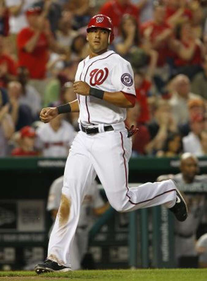 Nationals shortstop Ian Desmond (20) scores during the third inning. (Harry E. Walker / McClatchy-Tribune News Service)