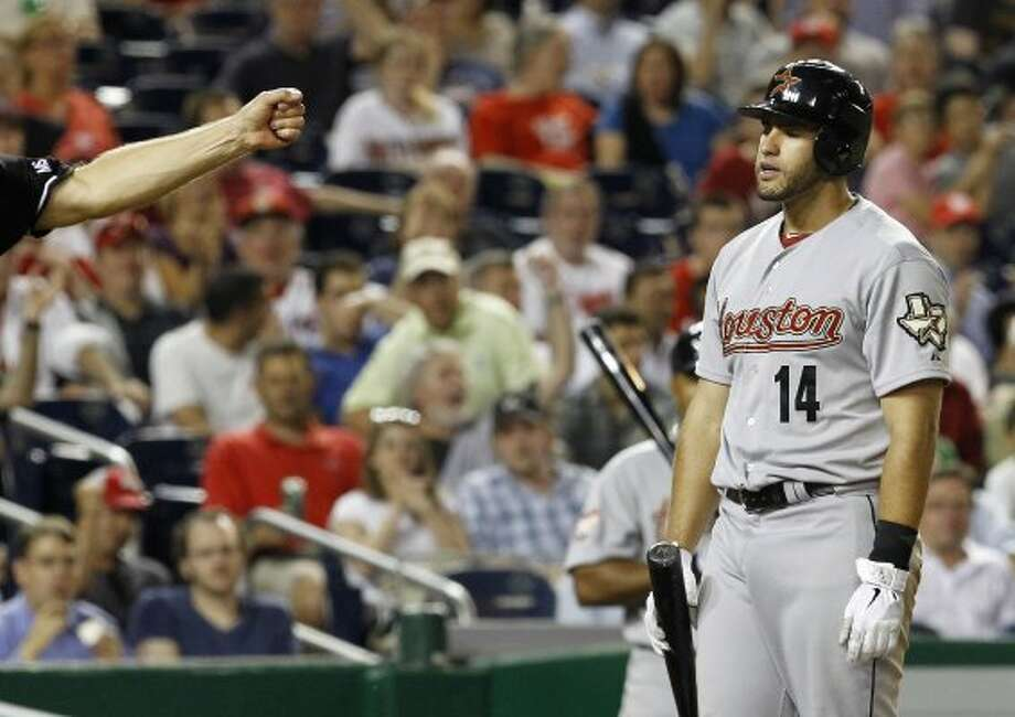 J.D. Martinez (14) reacts after striking out swinging against Washington Nationals relief pitcher Ryan Mattheus during the seventh inning. (Ann Heisenfelt / Associated Press)