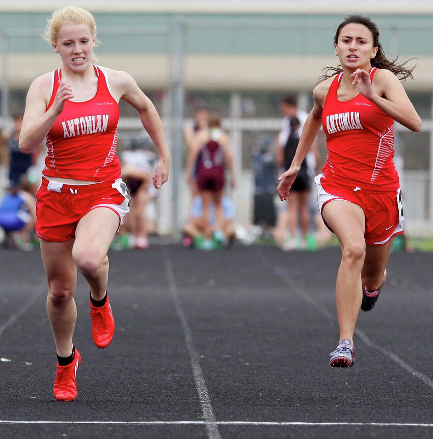 Antonian's Emily Leonard (left) and teammate Cassandra Santos head to the finish line in the 100-meter dash during the TAPPS 5A South Regional track meet held Monday April 16, 2012 at Central Catholic High School. Leonard finished first with a time of 13.06 and Santos finished second with a time of 13.18.