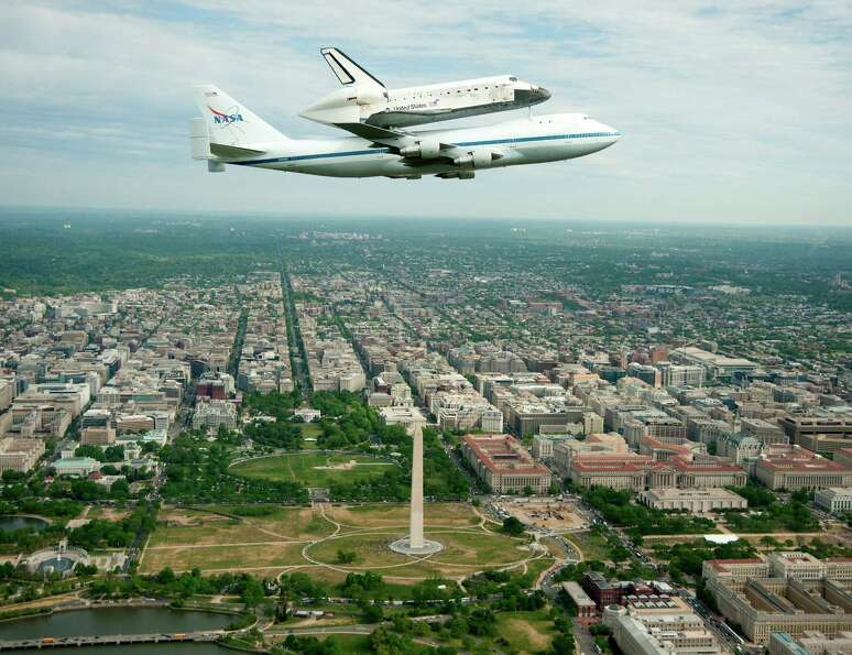 The Space shuttle Discovery, mounted atop a NASA 747 Shuttle Carrier Aircraft, flying over Washingto