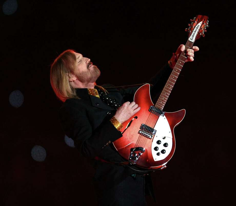(FILES) Photo dated February 3, 2008 shows US musician Tom Petty performing during halftime at Super Bowl XLII at the University of Phoenix Stadium in Glendale, Arizona. US police said on April 17, 2012 they had recovered five guitars stolen belonging to Tom Petty and Heartbreakers, earning them thanks from the US music veteran who is about to launch his latest tour. Petty had offered a $7,500 reward for information leading to the recovery of the guitars, including one of Petty's vintage, 12-string Rickenbackers, which helped the band produce its signature sound.           AFP PHOTO/FILES/Timothy A. CLARY (Photo credit should read TIMOTHY A. CLARY/AFP/Getty Images) Photo: TIMOTHY A. CLARY / AFP ImageForum