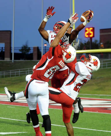 A pack of Lamar Cardinals go up for the ball during the Crawfish Bowl spring game at Lamar University in Beaumont, Tuesday,  April 17, 2012. Tammy McKinley/The Enterprise Photo: TAMMY MCKINLEY