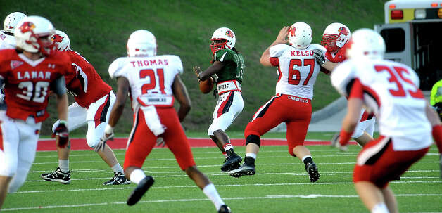 Jeremy Johnson looks to pass during the Crawfish Bowl Spring game at Lamar University in Beaumont, Tuesday,  April 17, 2012. Tammy McKinley/The Enterprise Photo: TAMMY MCKINLEY
