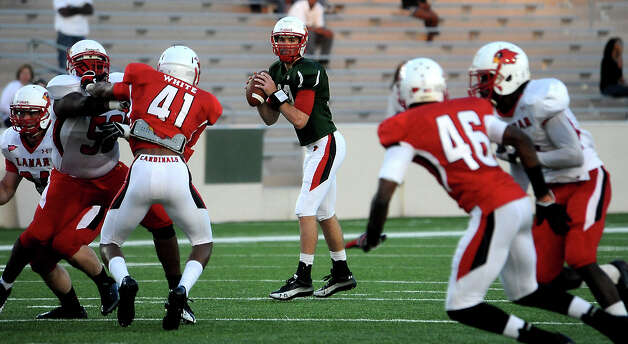 Caleb Berry looks to pass during the Crawfish Bowl spring game at Lamar University in Beaumont, Tuesday,  April 17, 2012. Tammy McKinley/The Enterprise Photo: TAMMY MCKINLEY