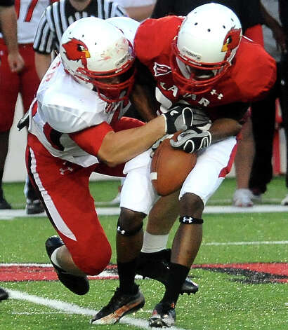 Joe Viator brings down Van Franks during the Crawfish Bowl Spring game at Lamar University in Beaumont, Tuesday,  April 17, 2012. Tammy McKinley/The Enterprise Photo: TAMMY MCKINLEY