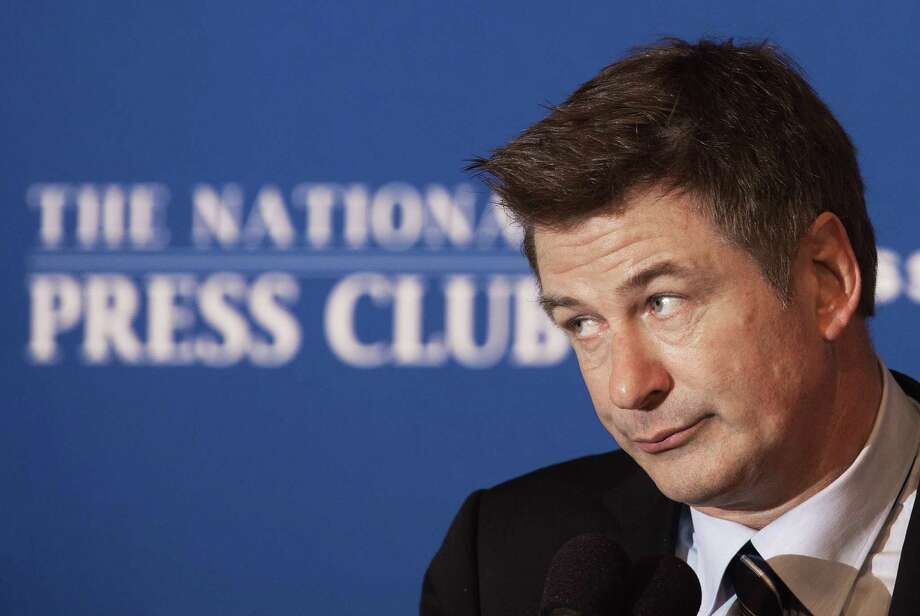 US actor Alec Baldwin, spokesman for Americans for the Arts, pauses as he mentions his recent American Airline experiences, during remarks at the National Press Club April 16, 2012, in Washington, DC. Baldwin spoke on the need to expand funding for the arts and answered questions about airline travel and politics.      AFP Photo/Paul J. Richards (Photo credit should read PAUL J. RICHARDS/AFP/Getty Images) Photo: PAUL J. RICHARDS