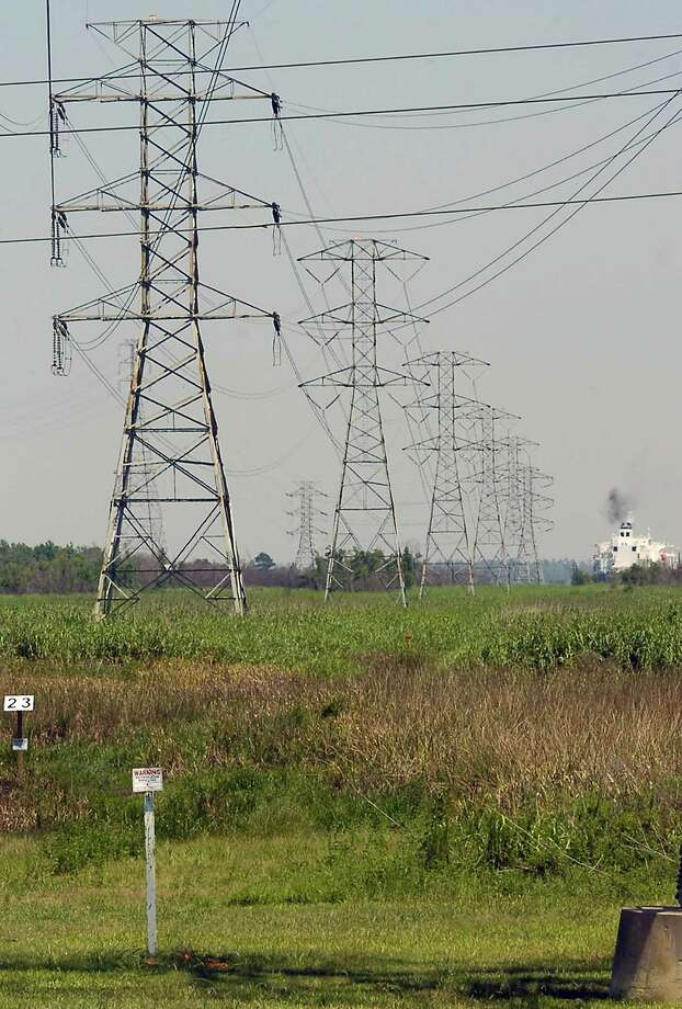 Entergy, which is spinning off its electricity transmission business, says accusations that it forced customers to buy power from more expensive plants are false.