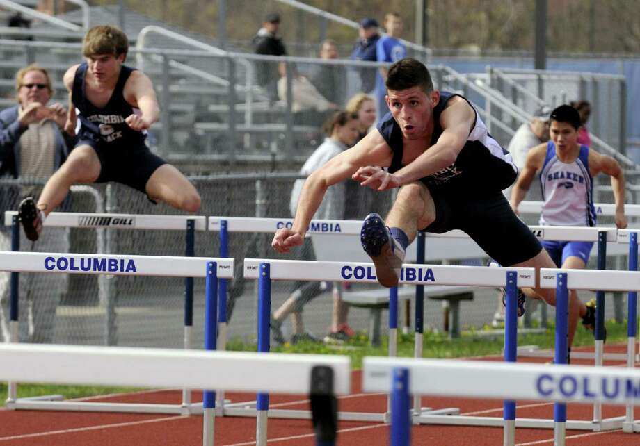 Columbia's Jake Alviene, right, flys to a victory in the 110 hurdles during a high school track meet at Columbia High School in East Greenbush N.Y. Tuesday April 17, 2012. (Michael P. Farrell/Times Union) Photo: Michael P. Farrell