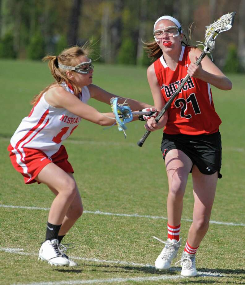 From left, Niskayuna's Jess Welge defends Guilderland's Morgan Hardt during a lacrosse game on April 17, 2012 in Niskayuna, N.Y. (Lori Van Buren / Times Union) Photo: Lori Van Buren